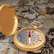 Old compass on map — Stock Photo