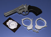 Police badge, gun and handcuffs — 图库照片