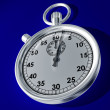 Stopwatch on a blue background — Stock Photo