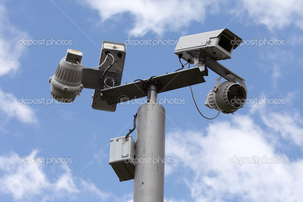 Security cameras watching over us on a sunny day  Stock Photo #2248021