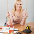 Architect woman holding meter frame — Stock Photo