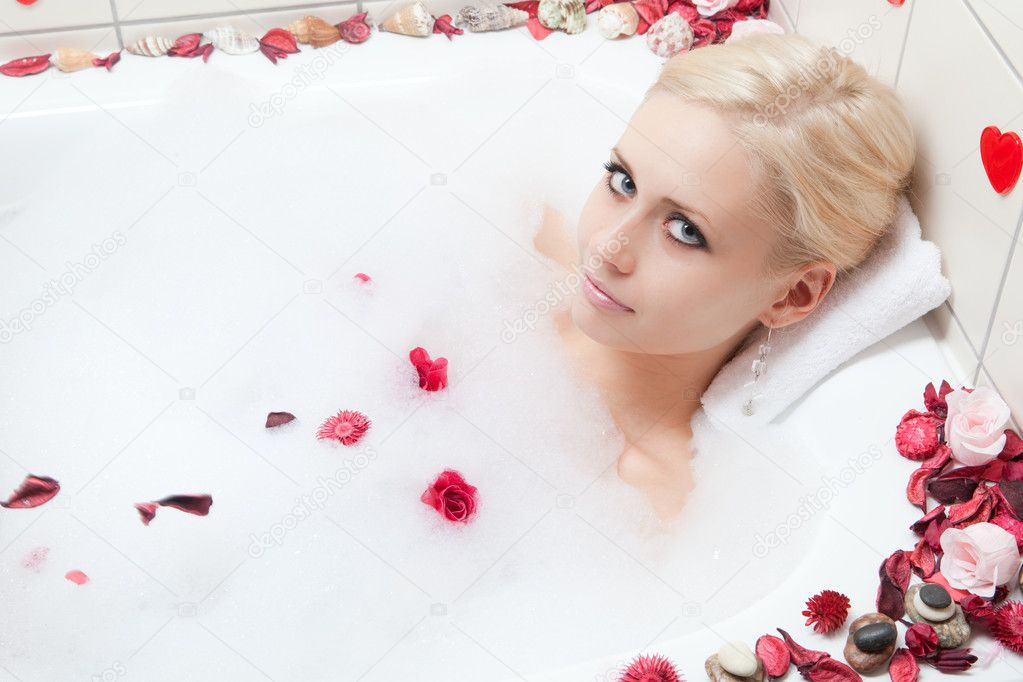 depositphotos 2382338 Woman bathing ... daily continental breakfast, adult entry to the Spa, tennis court hire, ...