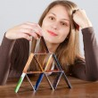 Womwith credit card pyramid — Stock Photo #2395881