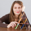 Woman with credit card pyramid — Stock Photo #2395918