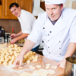 Cook men in kitchen — Stock Photo