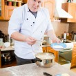 Cook man in kitchen — Stock Photo #2396580