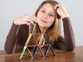 Woman with credit card pyramid — Stock Photo