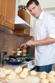 Cook man in kitchen — Stock Photo