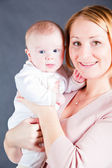 Young mother holding baby boy — Stock Photo