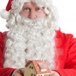Royalty-Free Stock Photo: Santa Claus holding house