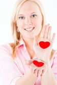 Young blond woman exposing hearts — Stock Photo