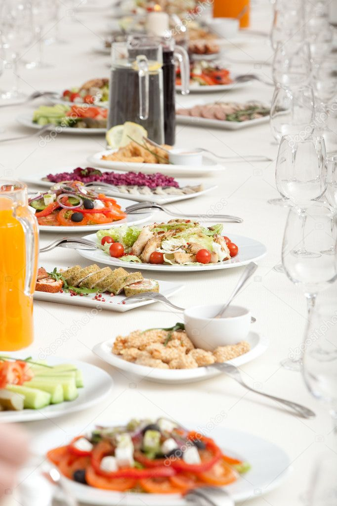 Long served restaurant table with snacks and salads — Stock Photo #2455796