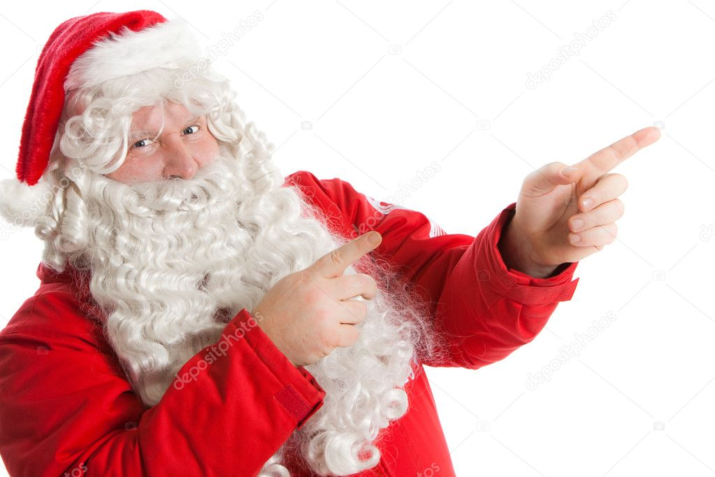 Funny Santa Claus showing in right direction with two fingers — Stock Photo #2459763