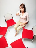 Business woman sitting in chair circle — Stock Photo