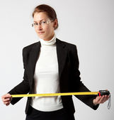 Business woman with tape-measure — Stock Photo