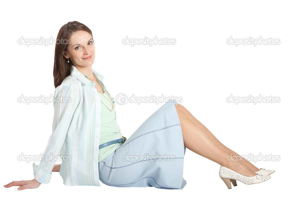 New Young Woman In A Beige Skirt Suit Sitting In A Swivel Chair  Stock