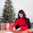 Business woman making christmas presents — Stock Photo