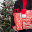 Business woman with christmas presents — Stock Photo