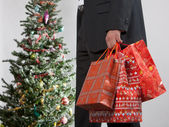 Business man with christmas presents — Stock Photo