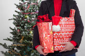 Business woman with christmas presents — Foto de Stock