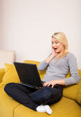 Surprised woman looking at computer — Stock Photo