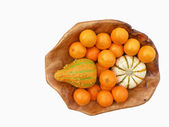 Tangerines and decorative pumpkins — Stock Photo