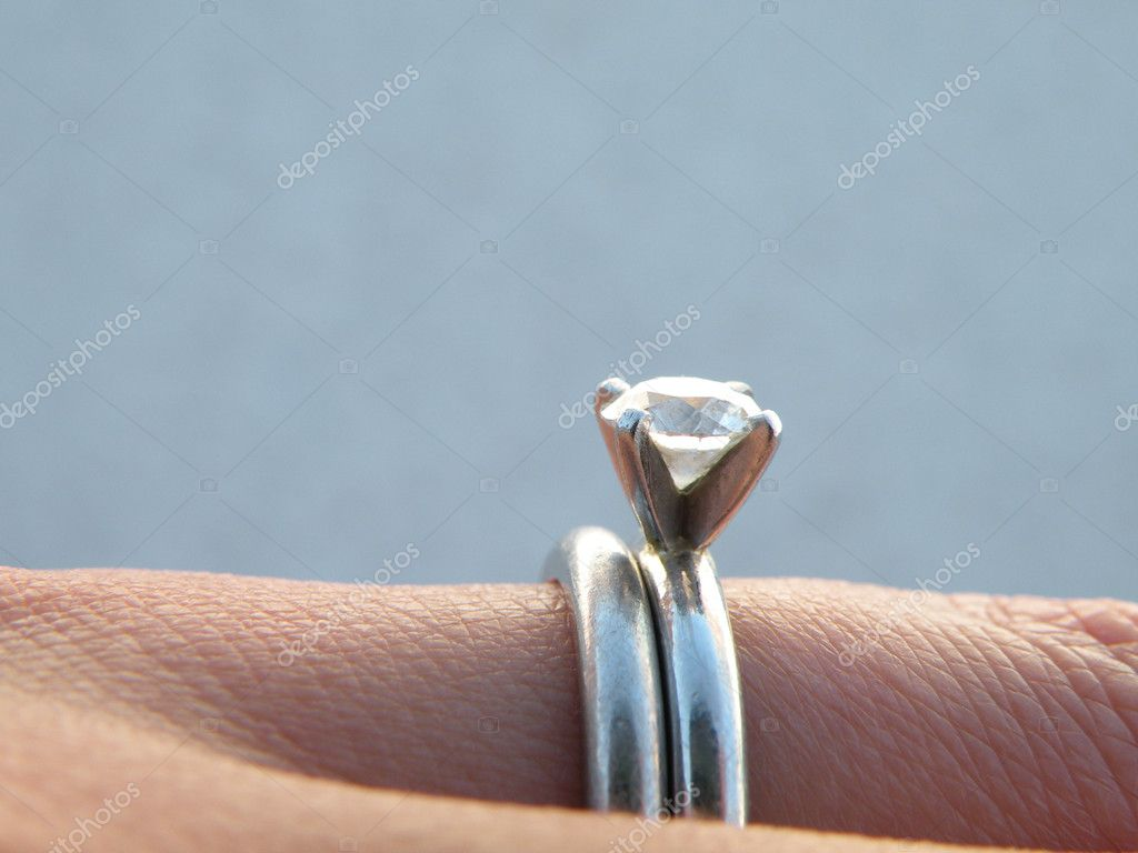 Detail photo of engagement and wedding rings on woman's hand — Stock Photo #2170877