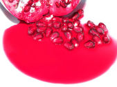 Red Pomegranate Juice and Seeds — Stock Photo