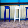Stock Photo: White & blue wooden bar chairs