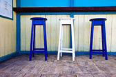 White & blue wooden bar chairs — Stock Photo