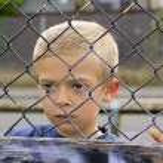 Child through fence — Stock Photo