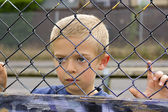 Child through fence — Stock Photo