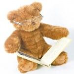 Teddy bear reading a book — Stock Photo #2276054