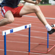 Stock Photo: Jumping over hurdle