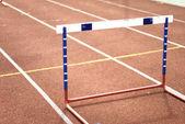 Single hurdle on a sports-ground — Stock Photo