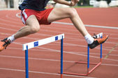 Jumping over the hurdle — Stock Photo