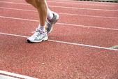 Feet on sports-ground — Stock Photo