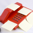 Stock Photo: Red telehone with memo