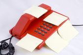 Red telehone with memo — Stock Photo