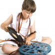 Winding up celluloid — Stock Photo