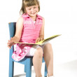 Cute little girl is reading — Stock Photo #2302925