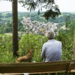 Man and dog at viewpoint — Stock Photo