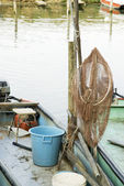 Fishing-net in the boat — Stock Photo