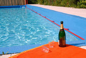 Champagne at the swimming pool — Stock Photo