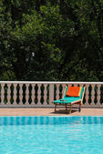 Sun bed at the swimming pool — Stock Photo
