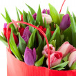 Colorful tulips in shopping bag — Stock Photo