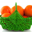 Oranges in green basket — Stock Photo