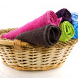 Basket with colorful towels — Stock Photo