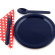 Blue plate with dotted napkin — Stock Photo