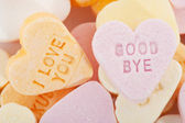 Love you and goodbye candy hearts — Stock Photo